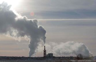 Exhaust from the Manitoba Hydro generation station in Brandon billows into the frigid air in January 2014.