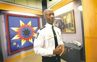 Winnipeg police Chief Devon Clunis in front of the aboriginal star  blanket.