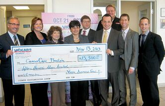 The Vickar Auto Group management team presents cheque for $15,300 to the CancerCare Manitoba Foundation.