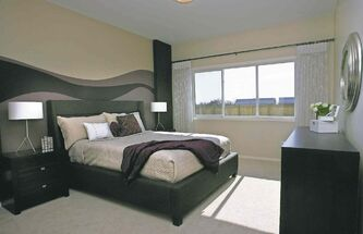 The master suite  is spacious and bright.
