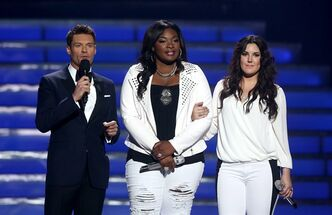 Host Ryan Seacrest, left, and finalists Candice Glover, center, and Kree Harrison speak on stage at the