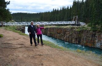 Prime Minister Stephen Harper and wife Laureen hike at the edge of Miles Canyon on the Yukon River in Whitehorse Monday.