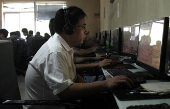 FILE - In this July 14, 2010 file photo, a Chinese man uses a computer at an Internet cafe in Beijing. China's new communist leaders are increasing already tight controls on Internet use and electronic publishing following a spate of embarrassing online reports about official abuses. The measures suggest China's new leader, Xi Jinping, and others who took power in November 2012 share their predecessors' anxiety about the Internet's potential to spread opposition to one-party rule and their insistence on controlling information despite promises of more economic reforms. (AP Photo/Ng Han Guan, File)