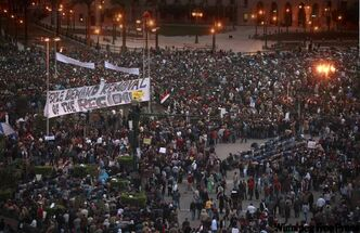 Ignoring the government set curfew, Egyptians gather in a massive crowd in Tahrir Square in Cairo in January 2011.