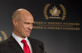 Tears roll down the cheek of former NHL great Mark Messier as he speaks during his induction into the Order of Hockey in Canada in Ottawa, Monday April 8, 2013. THE CANADIAN PRESS/Adrian Wyld
