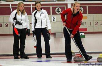 Cathy Overton and teammate Breanne Meakin watch opponent Chelsea Carey call a shot in a recent cash event.