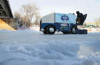 Patrick Jordon cruises down  the Assiniboine River, preparing the Arctic Glacier Winter Park  for the 2014 season.