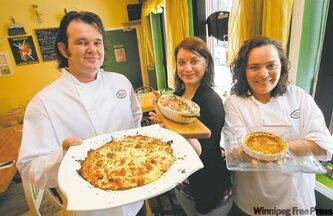 Chef and owner Stephane Wild, head waitress Caroline Rousseau and sous chef Lisa Chevrefils with some of the delightful items on Chez Sophie's menu.