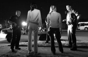 Police arrest two women for prostitution in Dallas, Texas.