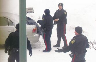 Police investigate the discovery of a body Thursday inside the trunk of a car on Pear Tree Bay in St. Vital. It is the city�s first homicide of 2013.