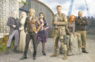 Defiance cast members Tony Curran (from left), Jaime Murray, Julie Benz, Mia Kirshner, Grant Bowler, Stephanie Leonidas and Graham Greene in the city protected by an electric force field.