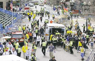 Emergency crews help the injured following an explosion at the finish line of the 2013 Boston Marathon .
