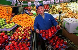 Joe Cantor is seen in the fruits and produce section of Cantor's Quality Meats and Groceries in a file photo.