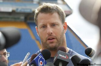 Winnipeg Blue Bomber Doug Brown speaks to reporters at practice Wednesday.