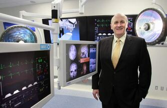 CEO David Graves stands in the image guidance lab at IMRIS in January 2011.