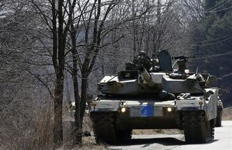 South Korea's K-1 tanks take part in their military exercise in the border city between two Koreas, Paju, north of Seoul, South Korea, Friday, March 29, 2013. North Korean leader Kim Jong Un warned Friday that his rocket forces were ready
