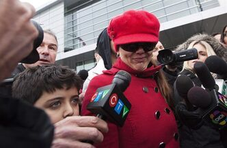 Yasmin Nakhuda and her 11-year-old son leave an Oshawa courthouse on Friday, December 21, 2012 after she was denied custody of her famed monkey Darwin. An Ontario judge has ruled Darwin will spend Christmas at the primate sanctuary where he's been staying since he was found wandering an Ikea parking lot. THE CANADIAN PRESS/Michelle Siu