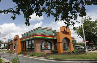 FILE-This Wednesday, June 6, 2012, file photo shows a Taco Bell restaurant in Richmond, Va. The fast-food chain announced Wednesday, April 10, 201 that it's exploring ways to offer more balanced choices and transparency. In a call with reporters, CEO Greg Creed said that could mean new products and reformulations of existing offerings. (AP Photo/Steve Helber, File)