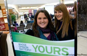 Suzie DeLuca (left) and Chantel Bage attended a public forum at the centre court of Kildonan Place shopping centre Sunday afternoon.