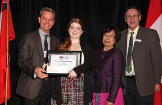 Erica Mitchell (second from left) receives her Student Citizenship Award from James Allum, Minister of Education and Advanced Learning, and Manitoba School Boards Association Region 5 directors Cory Juan and Michel Boucher at the Delta Winnipeg on March 13.