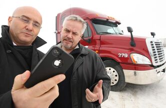 Traffilog's Michel Aziza, left, and Hans Peper can track vehicles on their smartphones.