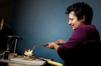 Aliza Amihude works in her studio on jewelry.
