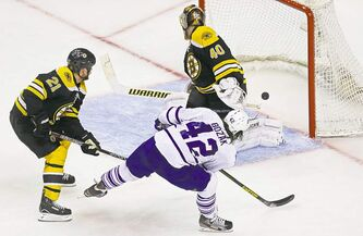 Tyler Bozak rips a shot past Boston Bruins goalie Tuukka Rask in the second frame.