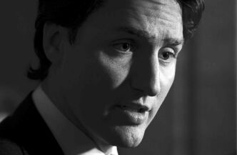 Liberal Leader Justin Trudeau speaks to reporters Wednesday after announcing  he is removing senators from caucus.