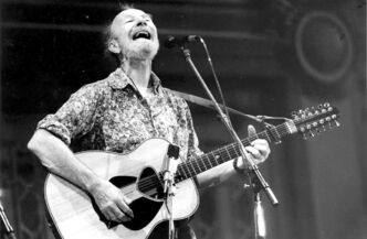 Pete Seeger performs at Soldiers and Sailors Memorial Hall in Pittsburgh in a September 1986 file image. Seeger died Monday at the age of 94, after a long career collecting and championing the folk songs of the United States as well as writing his own, according to news reports. He died of natural causes in a New York hospital. (Pittsburgh Post-Gazette/MCT)