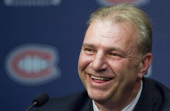 Michel Therrien smiles during a news conference in Brossard, Que., Tuesday, June 5, 2012, announcing him as new head coach of the Montreal Canadiens. THE CANADIAN PRESS/Graham Hughes