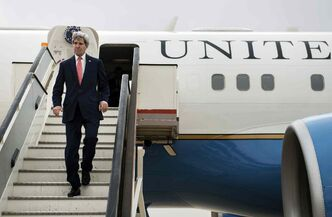 U.S. Secretary of State John Kerry arrives at Queen Alia International Airport in Amman, Jordan, Sunday, Jan. 5, 2014. Kerry has done Israelis and Palestinians a huge favor by pushing them to make one last try at negotiating a two-state solution, argues columnist Trudy Rubin.