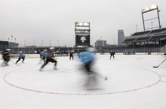 Omaha's junior hockey team, the Omaha Lancers, practice on the outdoor rink at TD Ameritrade Park in Omaha, Neb., Thursday, Feb. 7, 2013, where on Saturday the Nebraska-Omaha Mavericks will play North Dakota in a college hockey game. The rink sits between what would be first and third bases at the baseball stadium where the College World Series is played each June. (AP Photo/Nati Harnik)