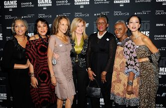 In this Oct. 18, 2011 photo, Huffington Post creator Ariana Huffington, center, poses with models, from left, Charlene Dash, Norma Jean Darden, Alva Chinn, Billie Blair, Bethann Hardeson and Pat Cleveland at the AOL Huffington Post Game Changers Awards at Skylight Soho in New York. These models walked in the Versailles fashion face-off in France in 1973. They are shown in a spread celebrating that almost 40-year-old fashion show in the May issue of O, The Oprah Magazine. (AP Photo/Evan Agostini)