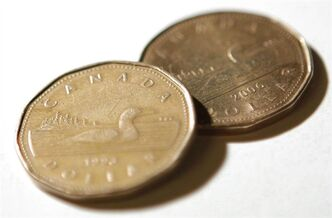 Canadian dollar coins, or Loonies, are shown in Ottawa on Oct. 10, 2008. THE CANADIAN PRESS/Sean Kilpatrick