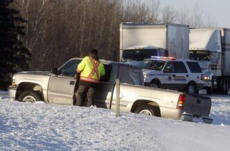 A pedestrian was killed about 6 a.m. today when struck by a vehicle in the eastbound lanes of the Trans-Canada Highway, about five kilometres east of Richer. The highway has been reopened to traffic. In the foreground a tow truck operator gets set to removed a truck stuck on the highway median.