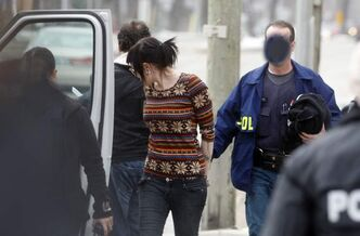 Two female suspects were taken into custody after Winnipeg police and RCMP raided The Joint at St. Mary's Road and St. Anne's Road Wednesday morning.  Faces of undercover police officers are obscured in this photograph to prevent their identification.