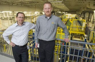 Project lead, plating expansion Paul Lefebvre (left), and director, technical and process improvement services Brad Penner stand by the expanded electro-plating line.