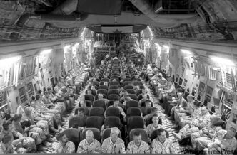 Canadian soldiers on a plane wait for takeoff from Kandahar on Tuesday.