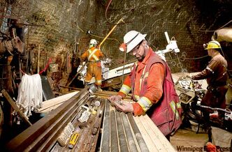 A geologist examines a drill core in the Rice Lake mine at Bissett.