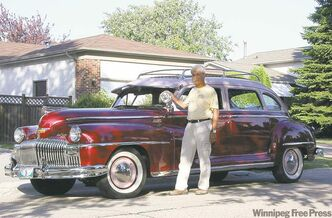 Otto So with his 1948 DeSoto Suburban.