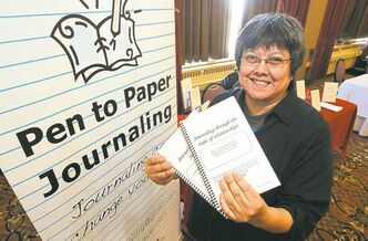 Workshop facilitator Leona Daniels with the journals.