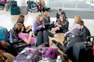 Students from Carberry Collegiate wait at the Winnipeg airport Friday after their flight to Toronto was cancelled. They were going to Greece over spring break for a class trip.