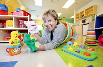 Sherry Shirritt, regional director of Kids & Company, tests the toys just before their grand opening this week on Fort Street.