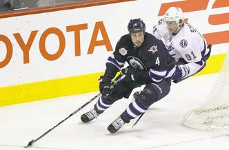 MIKE DEAL / WINNIPEG FREE PRESS archives Jets' Zach Bogosian in action against the Tampa Bay Lightning's Steven Stamkos last season. Bogosian has a year left on his contract.