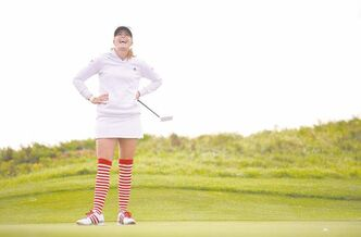 American Paula Creamer yuks it up while simultaneously making a bold fashion statement during  the delayed second round of play on day three of the Women's British Open at the Royal  Liverpool Golf Club.