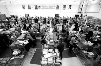 Volunteers pack the Samaritan's Purse warehouse in Calgary. Last year, Canadians donated 672,000 shoeboxes to the charity — 41,000 from Manitoba. At an orientation, volunteers, who work three-hour shifts, are asked to
