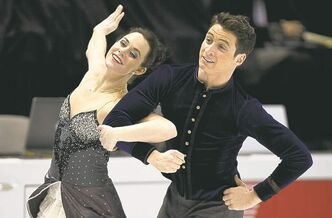 Tessa Virtue and Scott Moir are part world champion competitors, part welcoming committee.