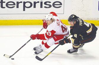 Detroit�s Darren Helm is chased  by Anaheim Ducks� Cam Fowler.