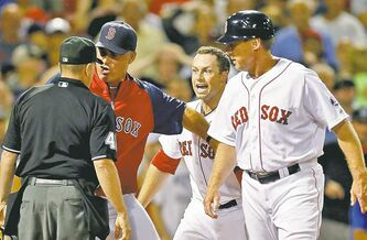 Boston Red Sox manager John Farrell, second from left, argues a call with home plate umpire Jerry Meals on Monday.