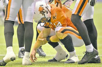 B.C. Lions quarterback Travis Lulay goes down in pain after rushing against Montreal. The extent of his shoulder injury isn't yet known.